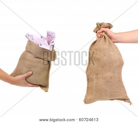 Two bags in hands.