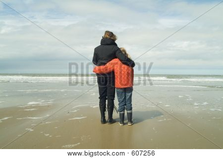 Mother And Daughter Overlooking The Sea