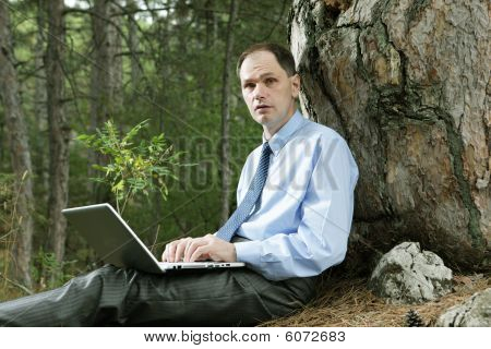 Businessman With Laptop Outdoors