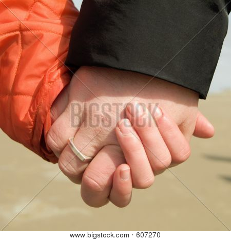 Mothe And Daughter Holding Hands