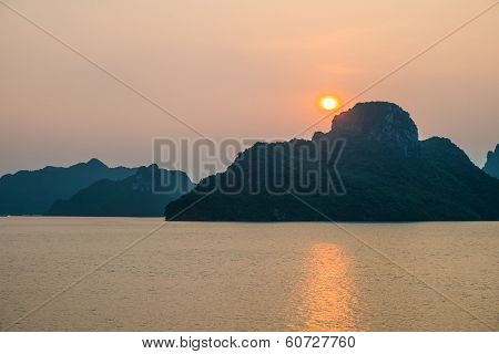 Sunset Over Mountains And Sea In Halong Bay