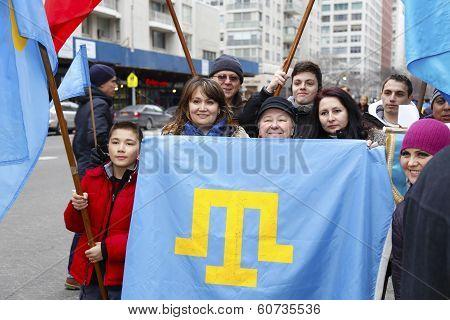 Family holding Crimean Flag