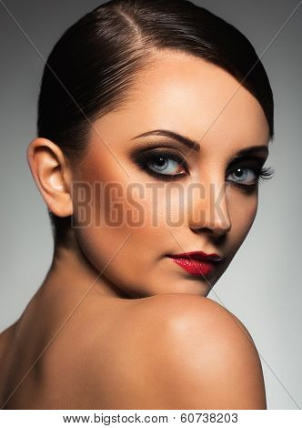 Portrait Of A Beautiful Woman With A Glamorous Retro Makeup