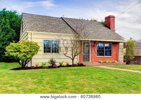 Beautiful Small Siding House With A Brick Trim Wall