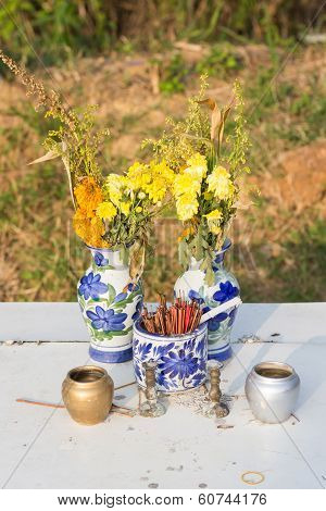 Joss Sticks And Flower In A Jar For A Spirit House With A Colorful Wreath In Thailand