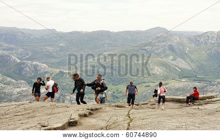 PULPIT ROCK, NORWAY - JULY 02. Tourists visit the Rock on July 02, 2010 in Lysefjorden, Norway.