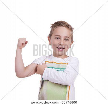 Smiling elementary boy flexing biceps