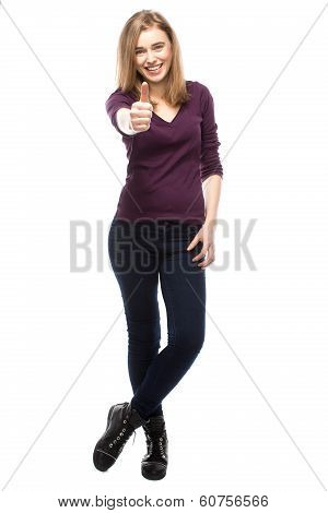 Enthusiastic Young Woman Giving A Thumbs Up