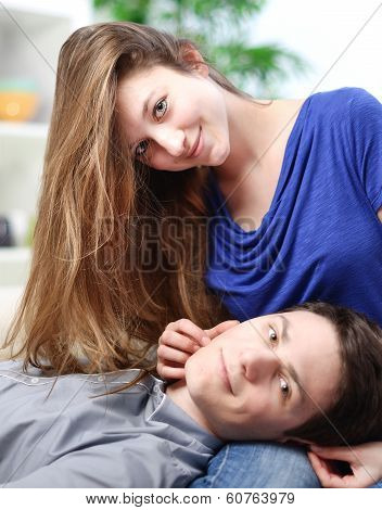 Cute Man Lengthened On The Thighs Of His Girlfriend On A Sofa