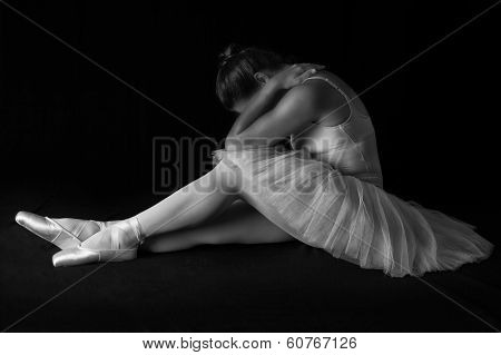 Female Dancer Sit On Floor Looking Sad In Artistic Conversion