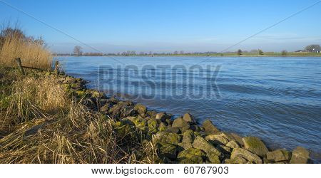Waves on a tranquil sunny river