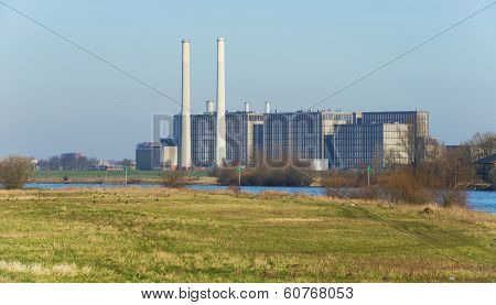Power plant along a river in winter
