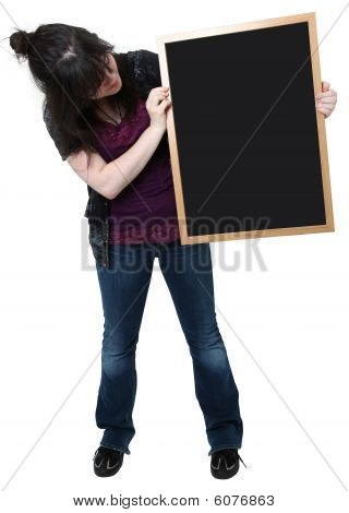 Sixteen Year Old Girl With Blank Chalkboard