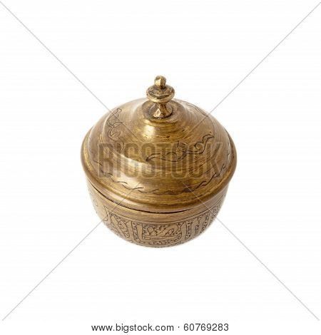 Vintage handmade sugar bowl of copper with oriental ornaments isolated over white