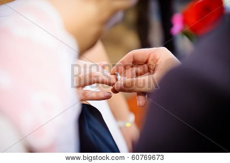 Putting Wedding Ring On Bride's Finger.