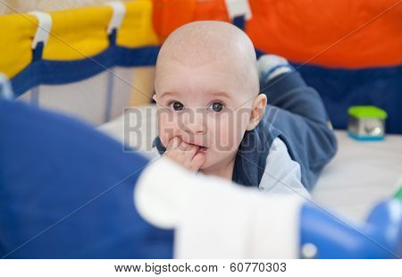 Baby In A Baby Cot