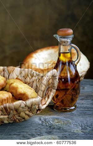 Bread In A Basket And An Olive Oil Bottle