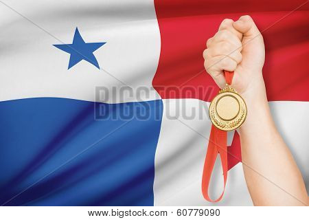Medal In Hand With Flag On Background - Republic Of Panama