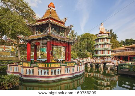 Chinese Pagoda And Pavilion By The Lake