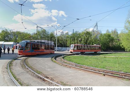 Two Orange Trams Unfold At Terminus In City At Sunny Summer Day