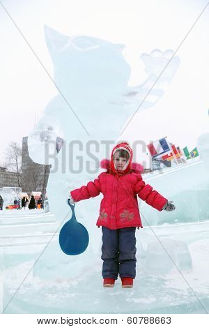 Perm, Russia - Jan 6, 2014: Little Girl Near Sculpture Of Snow Leopard - Winter Olympics Talisman In