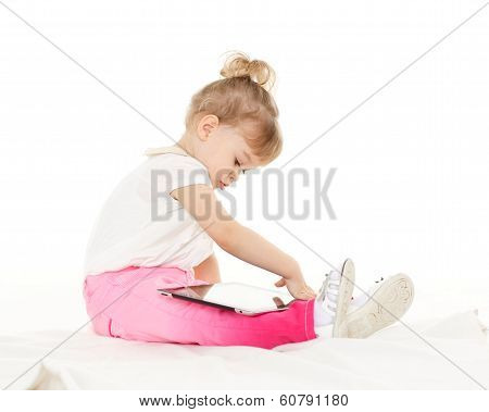 Small Girl With Computer Tablet.