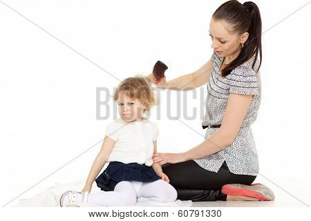 Mum Looks After Hair Of The Child..