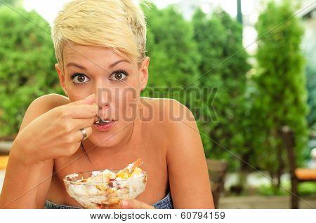 Young Women Eating Fruit Salad