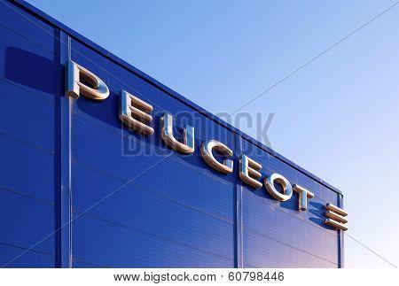 Samara, Russia - November 24, 2013: The Emblem Peugeot On The Building Of Official Dealer. Peugeot I