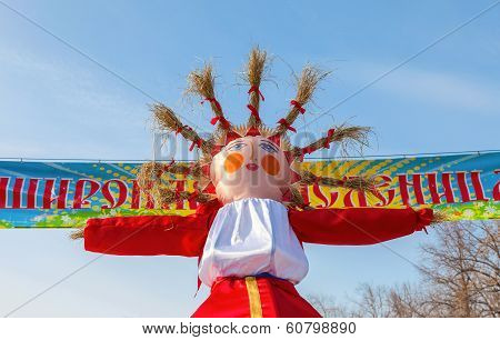 Shrovetide In Russia. Big Doll For The Burning On Blue Sky Background