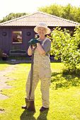 Active Senior Woman With Gardening Tools
