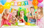 foto of clown face  - happy kids and clown at birthday party - JPG
