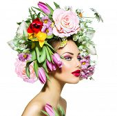 Spring Woman. Beauty Girl with Flowers Hair Style. Beautiful Model woman with Blooming flowers on he