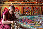 LADAKH, INDIA - SEPTEMBER 03, 2011: Buddhist monks making sand mandala in Diskit gompa at Nubra vall