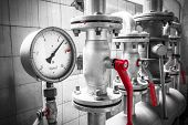 stock photo of gas-pipes  - A pressure gauge is an industrial pipe valves detail - JPG