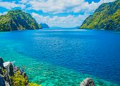 foto of deserted island  - Scenic view of sea bay and mountain islands Palawan Philippines - JPG