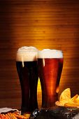 foto of crawdads  - Glasses of dark and light beer close up - JPG