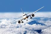 picture of chassis  - Airliner with stretched chassis flying over clouds - JPG