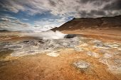 stock photo of northeast  - .The Namafjall geothermal field is located in Northeast Iceland, on the east side of Lake Myvatn. - JPG
