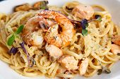 stock photo of crustaceans  - Creamy seafood pasta with salmon - JPG
