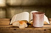 picture of communion  - still life with Bible chalice and bread