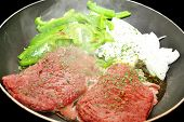 foto of steamy  - Steamy Cube Steaks Peppers and Onions in a Fry Pan - JPG
