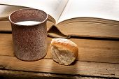picture of chalice  - still life with Bible chalice and bread