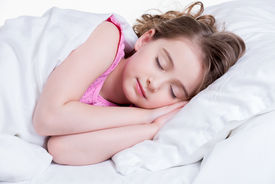pic of nighties  - Adorable little girl in pink nightie sleeps in the bed on a white background - JPG