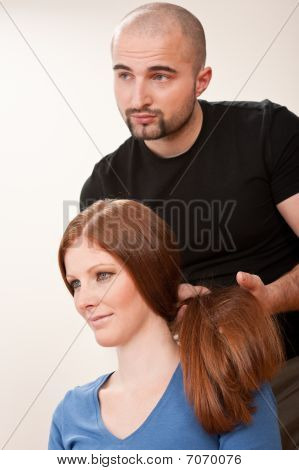 Professional Hairdresser With Long Red Hair Customer At Salon