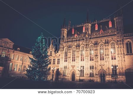 Illuminated Christmas tree on a Burg square in Bruges, Belgium