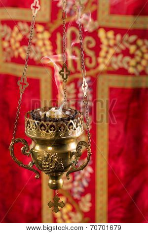 Copper church thurible with smoking incense in it