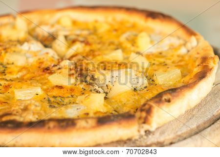 Baked Cut Pizza With Pineapple And Meat On Wooden Board