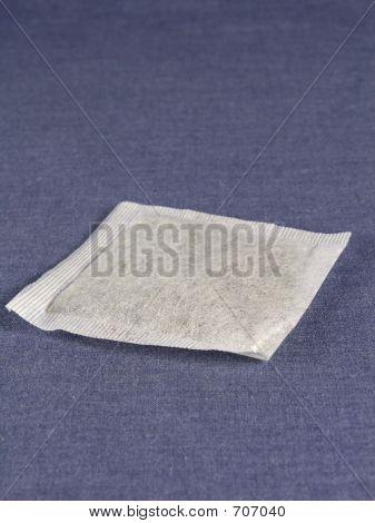tea bag on blue background