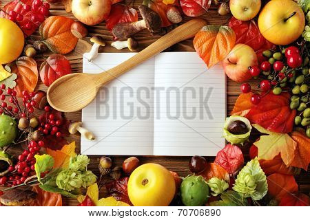 open cookbook. blank recipe book and food ingredients